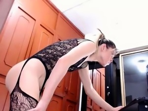 Seductive blonde shemale in black lingerie exposes herself