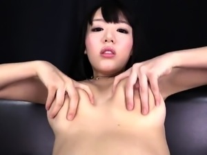 Sensuous Asian girl in stockings fucks herself with sex toys