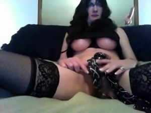 Seductive crossdresser in black lingerie masturbates