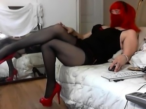 Elegant crossdresser in lingerie and high heels masturbates