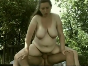 Fat milf Dandi enjoys jumping on a cock in the garden