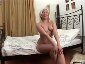 Ordinary looking auburn whore undresses to work on stiff cock