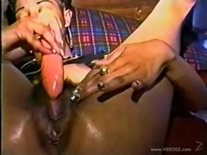 An ebony babe hammers her hairy pussy with a big toy