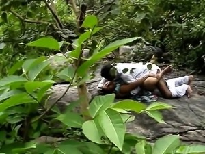 Two horny Oriental lovers enjoying hot sex in the outdoors