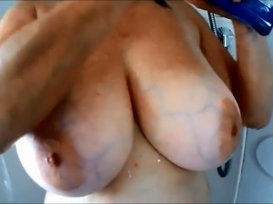 Big breasted mature wife is made to cum hard with sex toys