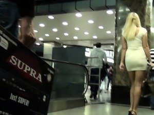 Sultry amateur blonde with sexy long legs upskirt in public