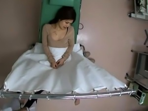 Attractive Oriental babe indulges in a hardcore threesome