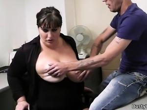 Busty secretary gives titjob and rides cock