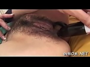 Bitch milf takes big dildo in booty and cunt while she moans