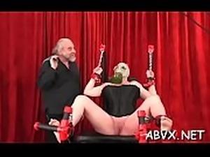 Sexy female fucked and stimulated in extraordinary bondage
