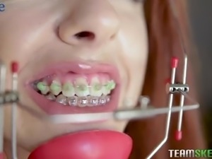 Red haired braceface Cleo Bardot gets nailed from behind damn well