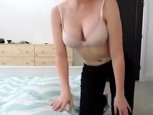 Stacked brunette drops her clothes and masturbates on webcam
