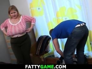 Well-shaped masseur doggy-fucks busty fat girl