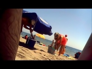 Nudist beach voyeur shoots a sexy mature lady with big boobs