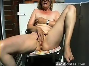 Mature Masturbating on the balcony