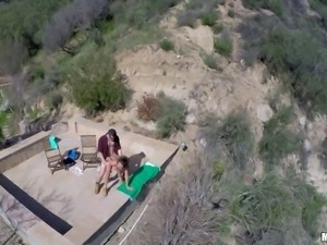 Couple outdoors in the desert caught fucking by a drone