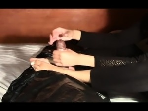 Amateur babe milks a big black cock with her hands and feet