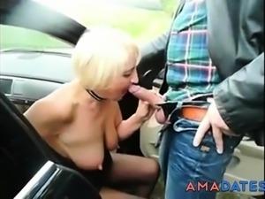 Old street prostitute serves customer outdoor