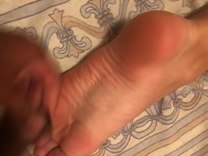 Footjob cum on soles