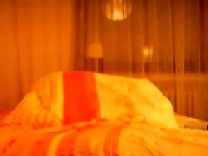 Nice blonde MILF masturbates on bed