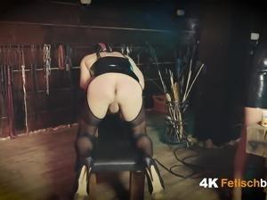 Domina tears the slave's ass open - German