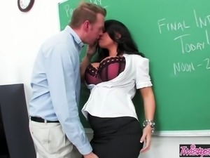 Big tit teacher Kerry Louise deep throats a cock