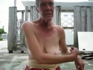 Mature flashing her saggy boobs