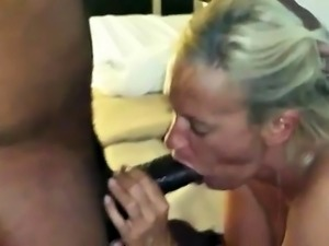 Horny mature blonde pleases a big black cock with her lips