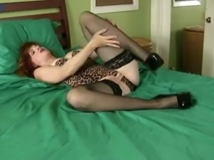 Naughty red haired mature woman in sexy stuff Amber Dawn masturbates