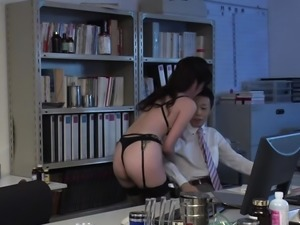 Oriental babe in stockings bows over for nasty fingering
