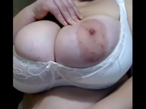 Mature big tits with big areoles in white bra close-up