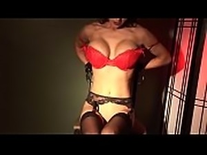 Black haired milf with a red dress and piercings undresses and masturbates on...