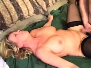 Blonde Asian bimbo with big boobs dildoes her fat pussy