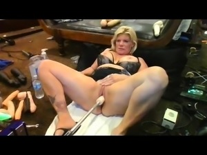 Busty mature enjoys toying
