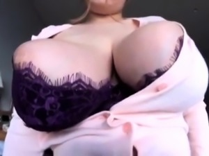 Voluptuous Japanese wife delivers a sensual titjob in POV