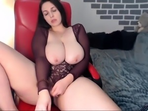 Big breasted brunette milf pleases her aching cunt on webcam