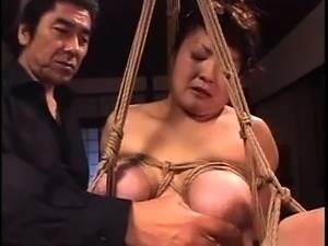 Curvy Asian mom gets tied up, covered in wax and fucked hard