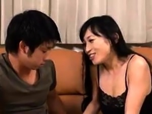 Stacked Japanese mom has a young cock making her pussy wet
