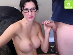 Busty woman doing blowjob on webcam show
