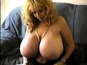 An MILF Shows How To Masturbate A Big Dick