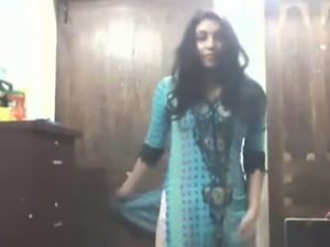 Cute long haired Indian gal shows off in her bright saris