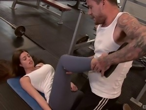 April seduces the handsome guy in the gym and lets him poke her pussy