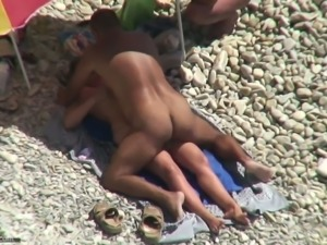 Tanned man fucks his wife on a nudist beach. Spy video