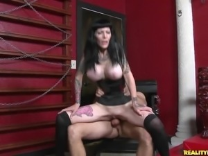 Tattooed mature whore with big fake tits gets fucked