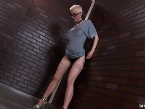Short hair blonde solo model giving toy handjob via gloryhole