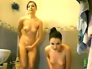 Two sexy roommates taking shower together in front of the camera0