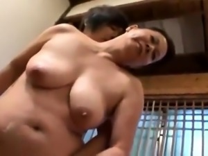Voluptuous Japanese cougar works her magic on a young cock