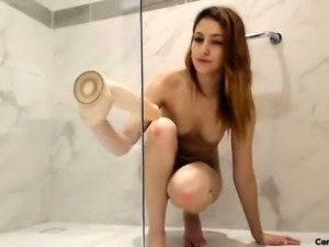 Hot european girl in bath uses shower head to masturbate