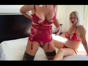 Two busty mature lesbians massaging each other on the bed