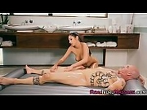 Sexy masseuse jerks cock